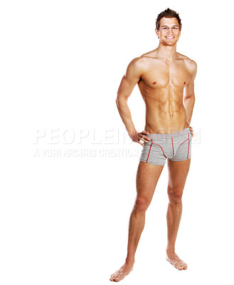 Buy stock photo Full length studio shot of a young man posing in his underwear isolated on white