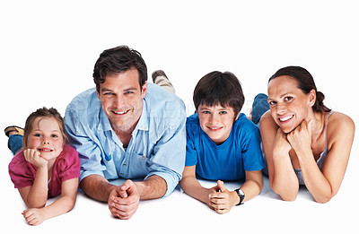 Buy stock photo Mother, father and children smiling, lying on the studio floor