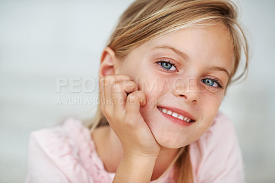 Buy stock photo Closeup portrait of pretty little girl smiling with hand on chin