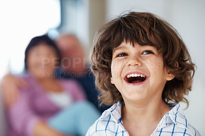 Buy stock photo Closeup of laughing little boy with grandparents in background