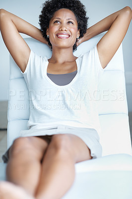 Buy stock photo Beautiful African American woman reclines back on lounge chair