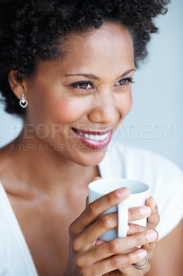 Buy stock photo Closeup of smiling African American woman relaxing with cup of tea