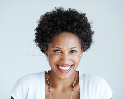Buy stock photo Portrait of charming African American woman smiling isolated on plain background