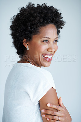Buy stock photo Attractive African American woman smiling on plain background