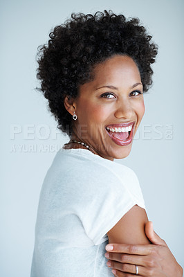 Buy stock photo Portrait of charming African American woman laughing on plain background