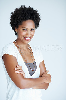 Buy stock photo Portrait of attractive African American woman smiling with hands folded