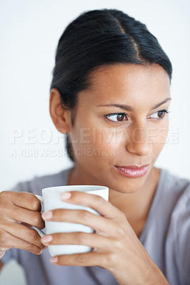 Buy stock photo Closeup of thoughtful mixed race woman having cup of coffee on plain background