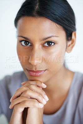Buy stock photo Closeup of confident mixed race woman looking at you