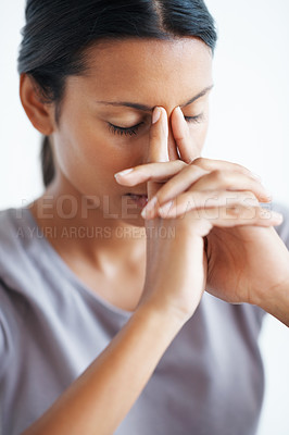 Buy stock photo Closeup of mixed race woman holding bridge of nose in pain