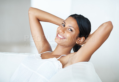 Buy stock photo Gorgeous mixed race woman resting on sofa in cheerful mood