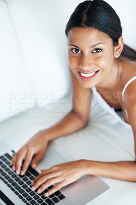 Buy stock photo High angle view of beautiful woman using laptop while lying on couch