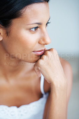 Buy stock photo Closeup of thoughtful mixed race woman looking away with hand on chin