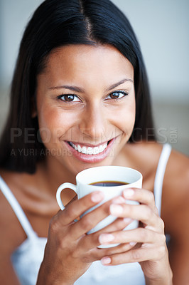 Buy stock photo Closeup of attractive mixed race woman relaxing with cup of coffee
