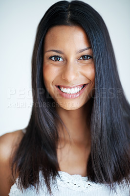 Buy stock photo Portrait of gorgeous mixed race woman smiling on plain background