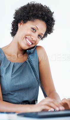 Buy stock photo Portrait of smiling business woman talking on phone while using computer