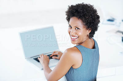 Buy stock photo Portrait of African American business woman smiling while working on laptop
