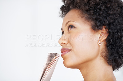 Buy stock photo Side view of African American woman looking away in deep thought
