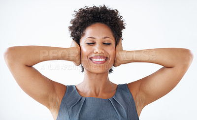 Buy stock photo Smiling African American woman with eyes closed covering ears over white background