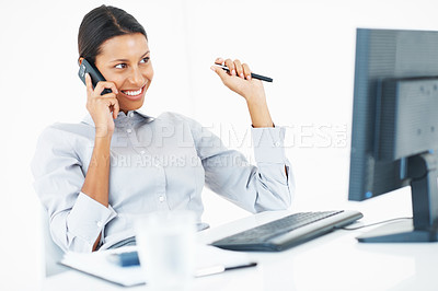 Buy stock photo Beautiful female executive smiling while using mobile at workplace