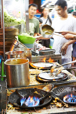Buy stock photo Busy chefs preparing food at a Thai streetmarket