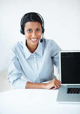 Buy stock photo Mixed race business woman with headset displaying laptop over white background