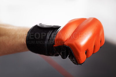 Buy stock photo Cropped shot of a martial artist's fist in a red kickboxing glove