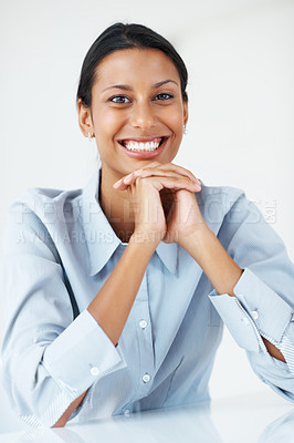 Buy stock photo Beautiful business woman smiling at desk with hands folded