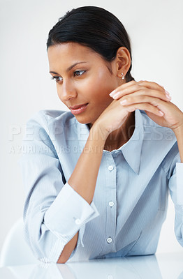 Buy stock photo Thoughtful business woman at desk looking away
