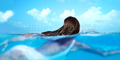 Buy stock photo Shot of a beautiful young woman swimming in blue ocean