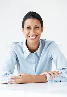 Buy stock photo Portrait of confident mixed race business woman smiling at desk