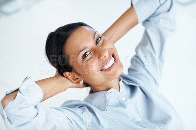 Buy stock photo Closeup of mixed race business woman relaxing at workplace