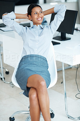 Buy stock photo Attractive business woman relaxing in office with hands behind head