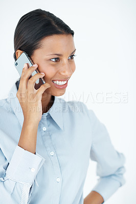 Buy stock photo Confident female executive using cellphone over white background