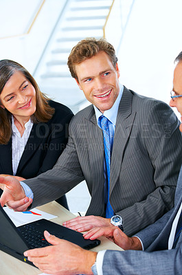 Buy stock photo Business team at a meeting in a light and modern office.
