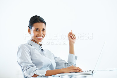 Buy stock photo Portrait of attractive mixed race business woman smiling while using laptop at office desk