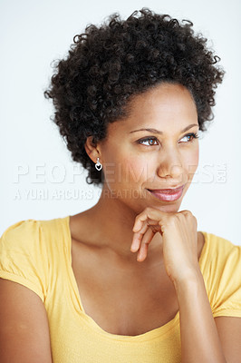 Buy stock photo Closeup of young African American woman with hand on chin thinking over white background