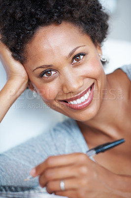 Buy stock photo Closeup portrait of gorgeous African American woman writing in diary while lying on couch