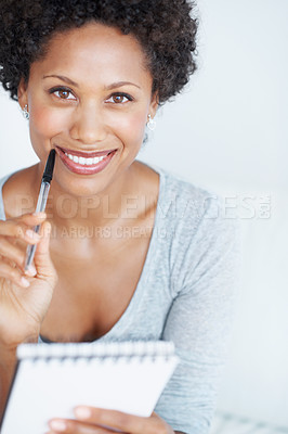 Buy stock photo Portrait of smiling African American woman holding pen and notepad