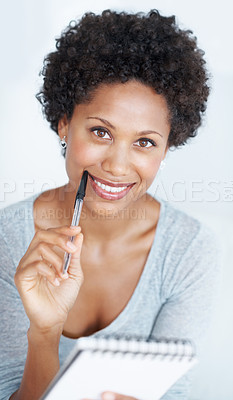 Buy stock photo Portrait of beautiful young woman smiling holding pen and notepad