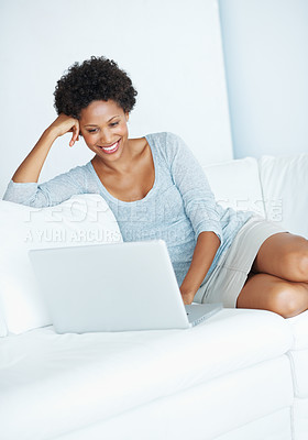 Buy stock photo Portrait of smiling African American woman using laptop in comfortable apartment