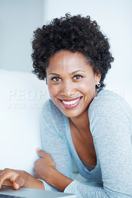 Buy stock photo Portrait of beautiful African American woman using laptop while lying on couch