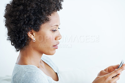 Buy stock photo Closeup of beautiful young woman texting on mobile phone over white background