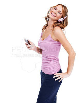 Buy stock photo Studio shot of a young woman listening to music through her headphones