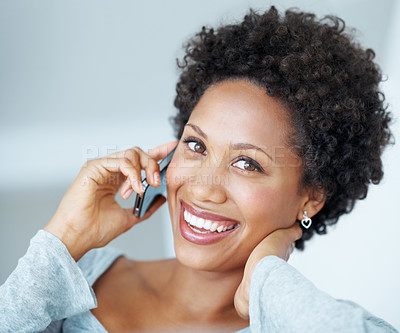 Buy stock photo Closeup of smiling young woman talking on cellphone