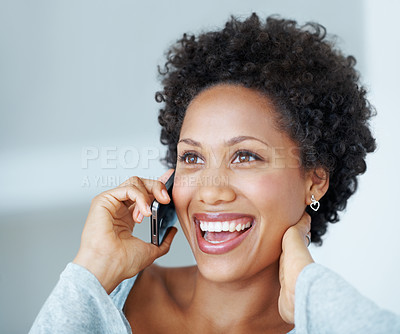 Buy stock photo Closeup of cheerful African American woman talking on cellphone