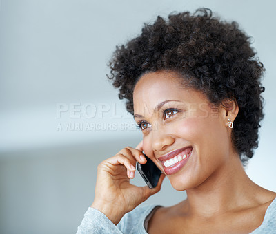 Buy stock photo Closeup of smiling young woman talking on mobile phone