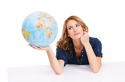Buy stock photo An inquisitive young beauty holding a globe of the Earth with Africa facing the camera
