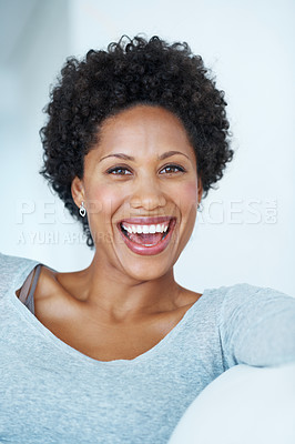 Buy stock photo Attractive African American woman laughing on couch