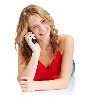 Buy stock photo A stunning young woman enjoying a conversation on her cellphone while isolated on white
