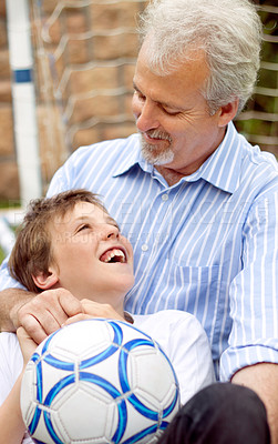 Buy stock photo Happy father and son playing around with a soccer ball